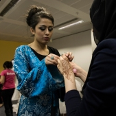 Finishing touches before gracing the catwalk